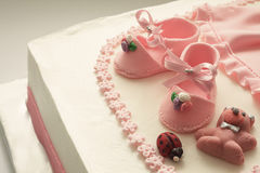 Sugar Shoes on Birthday Cake Stock Images