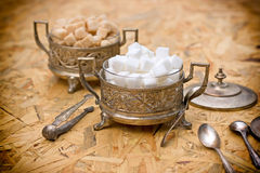 Sugar in silver containers - antique bowls Royalty Free Stock Photos