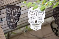 Sugar Skull Garland. A garland of paper cutouts of Mexican sugar skulls for the Day of the Dead Royalty Free Stock Photos
