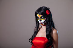 Sugar skull girl in red dress Stock Photo