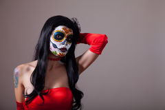 Sugar skull girl in red dress Stock Images