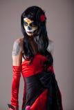 Sugar skull girl in red evening dress royalty free stock image