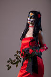 Sugar skull girl in red evening dress Royalty Free Stock Photography
