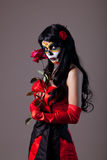 Sugar skull girl with red rose. Studio shot royalty free stock photo