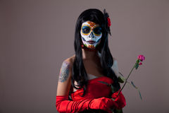 Sugar skull girl with red rose. Halloween shot royalty free stock photos