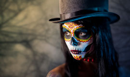 Sugar skull girl in tophat royalty free stock photos