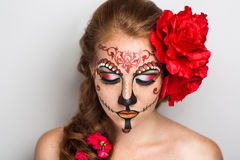 Sugar skull mask. Day of the Dead, Skull Mask. Art woman beautiful face painted as a traditional day of the dead, red flowers on head. Free place on photo for stock photography