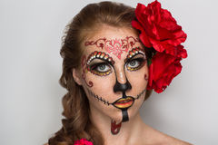 Sugar skull mask. Day of the Dead, Skull Mask. Art woman beautiful face painted as a traditional day of the dead, red flowers on head. Free place on photo for royalty free stock image