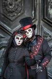 Sugar skull masked couple Stock Images