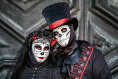 Sugar skull masked couple Royalty Free Stock Images
