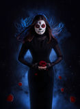 Sugar skull woman with rose Royalty Free Stock Images