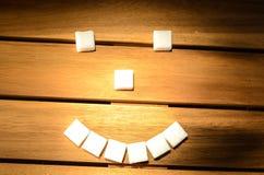 Sugar smile smiley. Of sugar cubes Royalty Free Stock Image