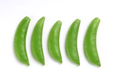 Sugar snap peas. In a row on white, product of kenya royalty free stock photo