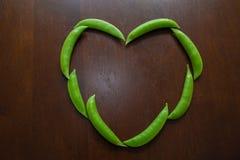 Sugar Snap Peas van hart Stock Afbeelding
