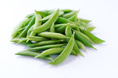sugar snap peas in white background. Green sugar snap peas in white background imported from guatemala Royalty Free Stock Photos