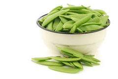 Sugar snaps in an enamel bowl Royalty Free Stock Images