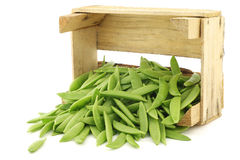 Sugar snaps in a wooden crate Stock Image