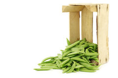 Sugar snaps in a wooden crate Royalty Free Stock Photography