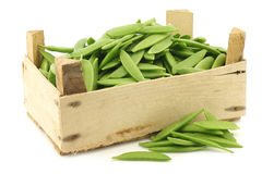 Sugar snaps in a wooden crate Royalty Free Stock Images