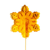 Sugar snowflake on a stick. Royalty Free Stock Images