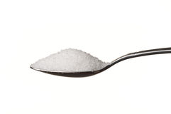 Sugar in a spoon. Isolated over white background Royalty Free Stock Photos