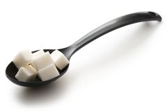 Sugar in a spoon Stock Image
