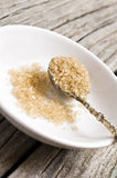 A Sugar spoon with brown sugar Royalty Free Stock Photography