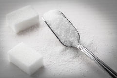 Sugar and spoon Stock Images