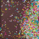 Sugar sprinkle dots, decoration for cake and bakery, as a background. On chocolate broun background,. Sugar sprinkle dots, decoration for cake and bakery, as a royalty free stock photography