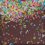 Sugar sprinkle dots, decoration for cake and bakery, as a background. On chocolate broun background,. Sugar sprinkle dots, decoration for cake and bakery, as a royalty free stock image