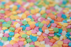 Sugar sprinkle dots, decoration for cake and bakery. A lot of sprinkles in a bucket on white wooden board background Royalty Free Stock Photography