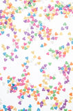 Sugar sprinkle dots hearts, decoration for cake and bakery, as a background Royalty Free Stock Images