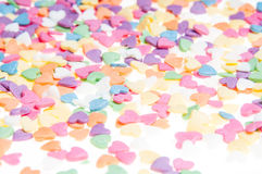 Sugar sprinkle dots hearts, decoration for cake and bakery, as a background. Sugar sprinkle dots, decoration for cake and bakery, a lot of sprinkles as a Stock Photography