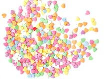 Sugar sprinkle dots hearts, decoration for cake and bakery. Colorful sugar sprinkles scattered on white background. Copy space for text stock photo