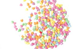 Sugar sprinkle dots hearts, decoration for cake and bakery. Colorful sugar sprinkles scattered on white background. Copy space for text stock image