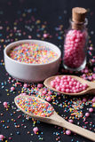 Sugar sprinkles on a black background Royalty Free Stock Photography