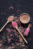 Sugar sprinkles on a black background Royalty Free Stock Photo