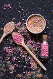 Sugar sprinkles on a black background Stock Photography