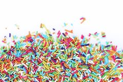 Sugar sprinkles. Colorful sugar sprinkles on a white background royalty free stock image