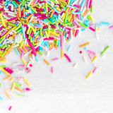 Sugar sprinkles on a white background as decoration for cake an. D bakery. Festive card for birthday, holiday event, party or Valentine`s day. Flat lay royalty free stock image