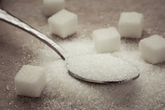 Sugar on stainless spoon Royalty Free Stock Photos