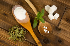 Sugar or stevia. Real sugar lumps and stevia in powder dried and tablet form Royalty Free Stock Photography