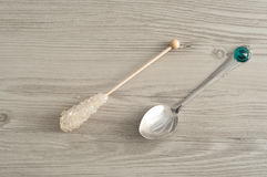 A sugar stick and a teaspoon Stock Images