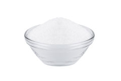 Sugar substitute xylitol, a glass bowl with birch sugar. Isolated on white royalty free stock image