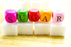 Sugar sweet cubes with colorful english alphabet high calories Stock Images