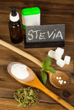 Sugar and sweetener stevia. Healthy sweetener stevia in liquid tablet dried and powder forms, plus real sugar lumps Stock Images