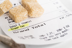 Sugar tax shown on restaurant bill Royalty Free Stock Photo