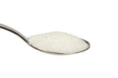 Sugar on a teaspoon. On a white background Stock Photos
