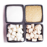Sugar types on white. Sugar types in black bowls isolated on white stock image