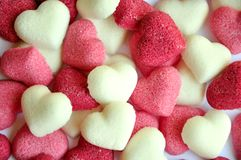 Sugar under heart forms. Pink, red and white hearts of heart. addiction to sugar concept. sweet background royalty free stock photos